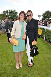 Left to right, MARITA GUGLIELMI and FRANCESCA CUMANI at the Qatar Goodwood Festival - Ladies Day held at Goodwood Racecourse, West Sussex on 30th July 2015.