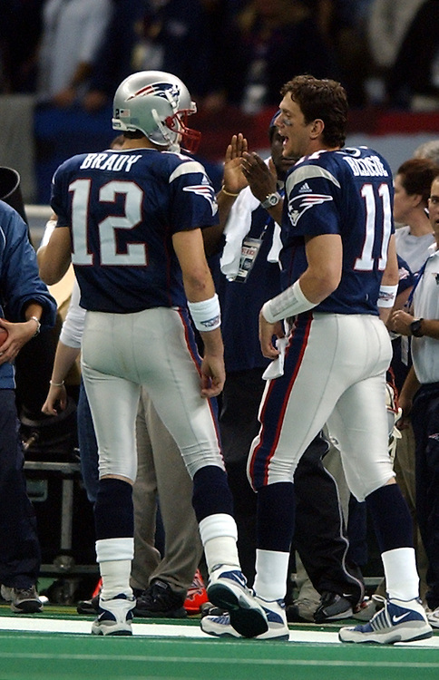 (2/4/02 New Orleans, Lousiana) Super Bowl Patriots vs Rams. Pats QBs Drew Bledsoe, right, and Tom Brady confer on the upcoming final drive that led to the game winning field goal. (020302patsmjs-Staff photo byMichael Seamans. Saved in photo mon/FTP.)