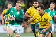 Keith Earls of Ireland runs with the ball while Nick Phipps of the Australian Wallabies gives chase during the Australian Wallabies vs Ireland second Mitsubishi Estate test match at AAMI Park, Melbourne, Australia on 16 June 2018. Picture by Martin Keep.
