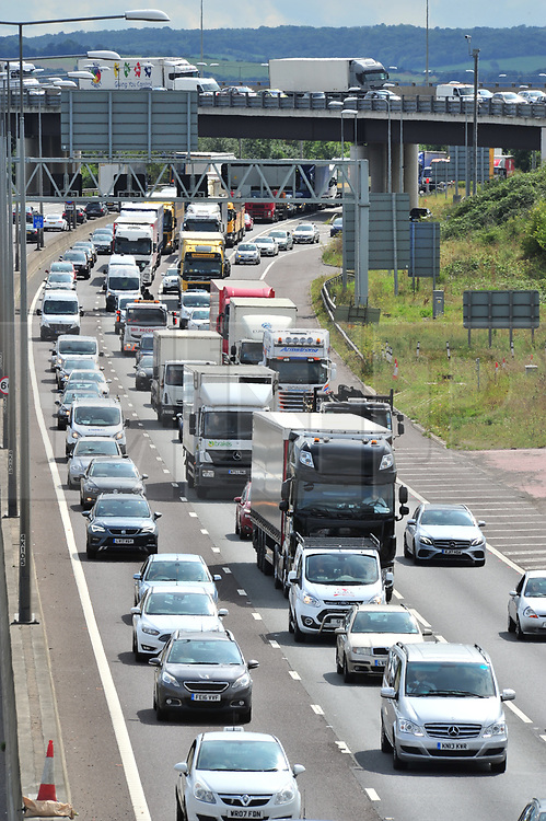 &copy; Licensed to London News Pictures.24/08/2017.<br /> Dartford,UK.<br /> The August bank holiday getaway seems to have started early today (2pm) on the M25 Anticlock-wise, junction two towards the Dartford crossing with miles of slow moving cars ,caravans and trucks, as people take a four day weekend break.<br /> Photo credit: Grant Falvey/LNP