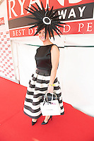 31/07/2014 Repro Free Sporting a hat designed by Galway based milliner Edel Ramberg, Paula Clancy from Inverin, Co.Galway was the winner of the Anthony Ryans Best Hat Competition. The winning hat featured a monochrome sunburst with French goose feathers in a spiked beret style. Photo:Andrew Downes