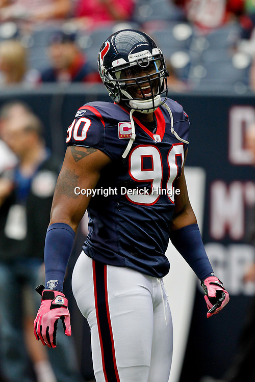 October 10, 2010; Houston, TX USA;Houston Texans defensive end Mario Williams (90) on the field during warms ups prior to kickoff of a game against the New York Giants at Reliant Stadium. Mandatory Credit: Derick E. Hingle