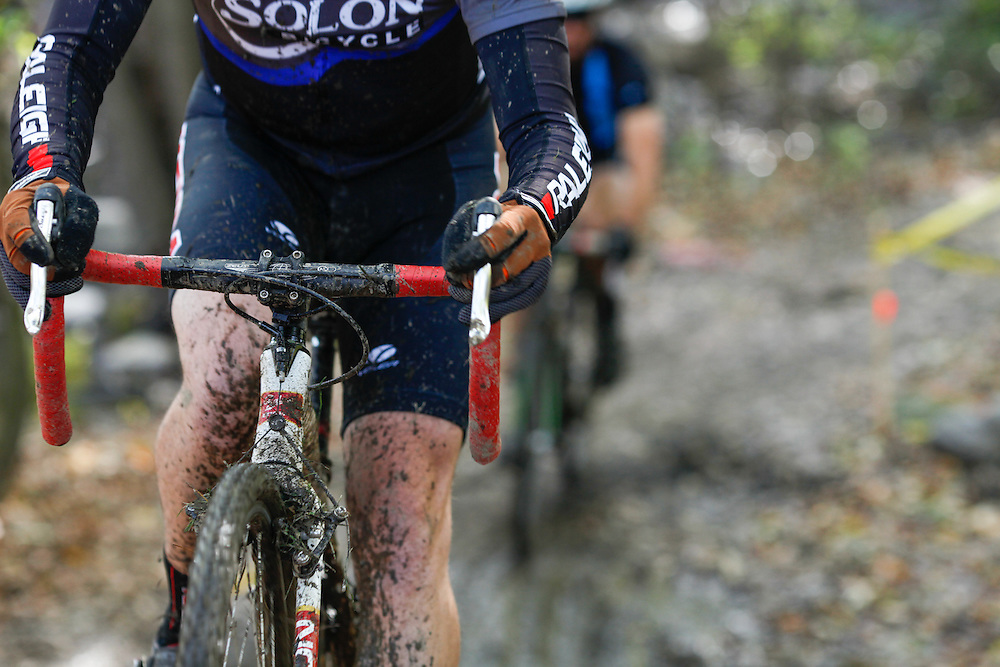 Racers navigate a muddy section at the 2011 Euclid, Ohio cyclocross race.