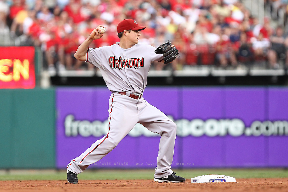 29 June 2010: Arizona Diamondbacks second baseman Kelly Johnson (2) turns a double play at second during the Diamondbacks game against the St. Louis Cardinals  at Busch Stadium in St. Louis, Missouri.