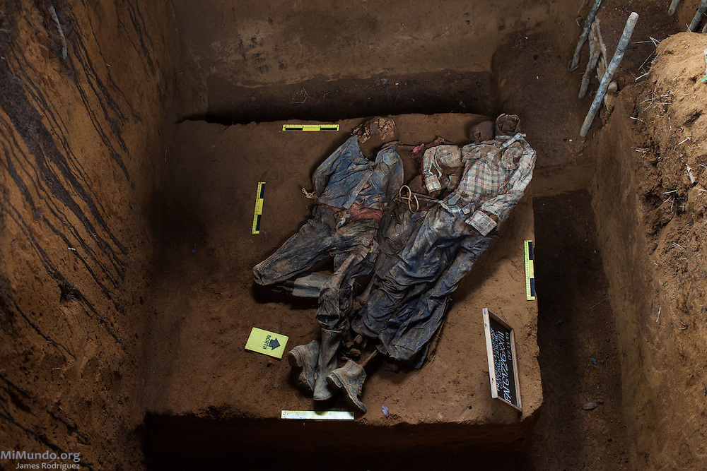 Grave 23 at the former military garrison of Cotzal contains the human remains of three men wearing civilian clothing with their hands bound and tied. The exhumation, carried out by the Forensic Anthropology Foundation of Guatemala (FAFG), took place from August 28th until November 8th, 2014, and rendered the skeletal remains of 74 wartime victims from 24 different graves. Xolosinay, San Juan Cotzal, Quiche, Guatemala. November 7, 2014.