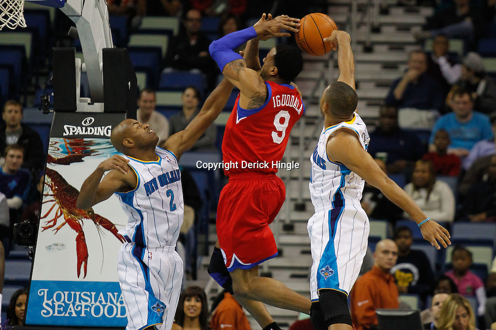 January 4, 2012; New Orleans, LA, USA; New Orleans Hornets shooting guard Eric Gordon (10) blocks a shot by Philadelphia 76ers small forward Andre Iguodala (9) as point guard Jarrett Jack (2) defends during the first quarter of a game at the New Orleans Arena.   Mandatory Credit: Derick E. Hingle-US PRESSWIRE