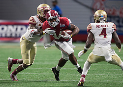 Alabama Crimson Tide running back Damien Harris (34) during the Chick-fil-A Kickoff NCAA football game on Saturday, September 2, 2017, in Atlanta. (Jason Parkhurst via Abell Images for Chick-fil-A Kickoff Game)