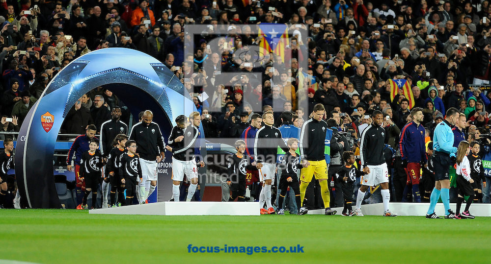 The players of FC Barcelona and A.S. Roma enter the filed of play for the UEFA Champions League match at Camp Nou, Barcelona<br /> Picture by Stefano Gnech/Focus Images Ltd +39 333 1641678<br /> 24/11/2015