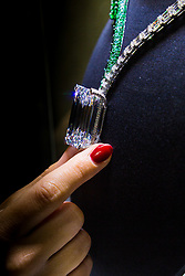 Christie's, London, October 03 2017. A woman handles a 404 carat-rough diamond, discovered in early 2016 that has been transformed by de GRISOGONO in Geneva by a team of 14 craftsmen who worked for over 1,700 hours to create a spectacular necklace mounting, the largest, flawless, D-colour diamond ever to come to auction, expected to fetch in the region of US$30 Million.<br />  <br /> Christie's will offer the diamond at its sale of Magnificent Jewels on 14 November in Geneva. The necklace represents a celebration of THE ART OF de GRISOGONO on the eve of the company's 25th anniversary and is on public preview  at Christie's in London from 3-7 October 2017. © Paul Davey