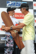 November 4th 2010: Nat Young presents Antoine Delpero with his runners up trophy after the final of the ASP World Longboard Championship at Makaha Oahu-Hawaii. Photo by Matt Roberts/mattrIMAGES.com.au