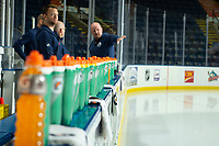 KELOWNA, BC - SEPTEMBER 23: Edmonton Oilers' staff stand on the bench prior to practice  at Prospera Place on September 23, 2019 in Kelowna, Canada. (Photo by Marissa Baecker/Shoot the Breeze)