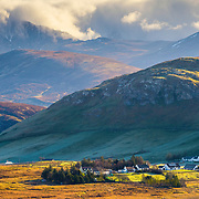 Springtime sun breaks over the bonnie wee village of Elphin, Assynt.