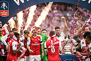 Arsenal players celebrate Arsenal midfielder Aaron Ramsey (8), Arsenal defender Hector Bellerin (24), Arsenal forward Olivier Giroud (12), Arsenal forward Theo Walcott (14) the The FA Cup Final match between Arsenal and Chelsea at Wembley Stadium, London, England on 27 May 2017. Photo by Sebastian Frej.