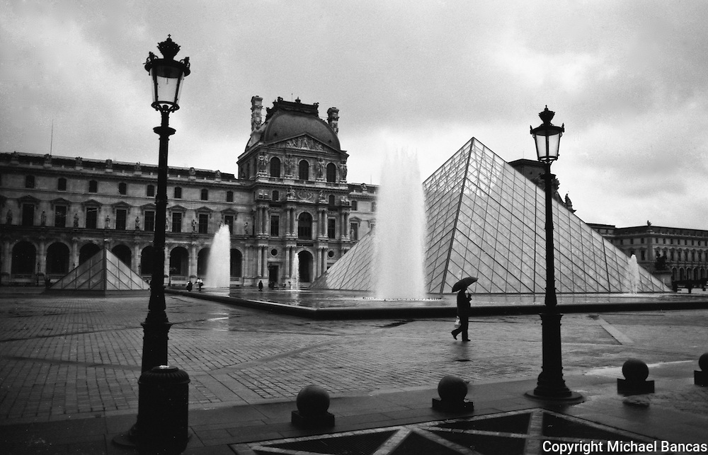 The Louvre Pyramid, Pyramide du Louvre, and the Louvre on a rainy October fall day in Paris