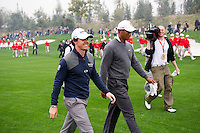 Rory McIlroy of Northern Ireland and Tiger Woods of USA walk down the fairway together during the Duel at Jinsha Lake at the Golf Villa Jinsha Lake on October 29, 2012 in Zhengzhou, China. McIlroy beat Woods by a single stroke shooting a 67 to Wood's 68.  Photograph by David Paul Morris