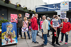 © Licensed to London News Pictures . 29/09/2017 . Torquay , UK . Protesters including one carrying a banner featuring Nigel Farage as Adolf Hitler , outside the venue . The UK Independence Party Conference at the Riviera International Centre . UKIP is due to announce the winner of a leadership election which has the potential to split the party . Photo credit: Joel Goodman/LNP