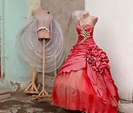 EN:A bridal shop in the town of Marneuli.<br /> According to the Azeri tradition two separate weddings take place: one for the groom, where women need to wear white dresses, and one for the women, where the brides need to wear colored dresses. Women normally rent rather than buy their wedding dresses.<br /> Kvemo Kartli region, Georgia, 2016.<br /> <br /> SP: Tienda de novias en la ciudad de Marneuli.<br /> Según la tradición, no hay una sino dos bodas: la de la mujer, en la que la novia lleva un vestido de colores y a la que menudo el novio no atiende, y la del hombre, en la que el vestido blanco de novia es de rigor.