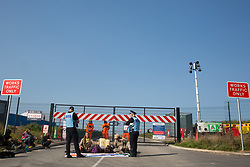 Environmental activists from HS2 Rebellion use a lock-on arm tube to block a gate to the South Portal site for the HS2 high-speed rail link on 14 September 2020 in West Hyde, United Kingdom. Anti-HS2 activists blocked two gates to the same works site for the controversial £106bn rail link, one remaining closed for over six hours and another for over twelve hours.