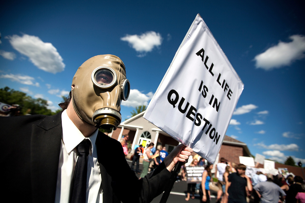 """Joe Hastings 3000 (the full name he gave) held a sign with protestors at the dental office of Walter James Palmer in Bloomington, MN, July 29, 2015.  Hastings said, """"It's a respect of all life issue, not just an animal rights issue."""""""
