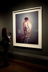 © Licensed to London News Pictures. 30/10/2012. London, UK. A visitor to the National Gallery views Richard Learoyd's 'Man with Octopus Tattoo' (2011) at the press view for an exhibition at the London based gallery today (30/10/12). The exhibition, entitled 'Seduced by Art: Photography Past and Present', running from 31 October 2012 - 20 January 2013, is the National Gallery's first major exhibition of photography and examines the relationship between photography and traditional fine art painting. Photo credit: Matt Cetti-Roberts/LNP