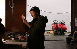 USA ALASKA BERING SEA 16JUL12 - Kirk Sato of the USA, biologist from the Scripps Institution of Oceanography examines samples taken from the seafloor in the Pribilof Canyon by a submersible craft, on loan from the Waitt Institute.......The Greenpeace ship Esperanza is on an Arctic expedition to study unexplored ocean habitats in the Bering and Chukchi Seas threatened by offshore oil drilling, as well as industrial fishing fleets.......Photo by Jiri Rezac / Greenpeace......© Jiri Rezac / Greenpeace