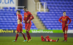 READING, ENGLAND - Wednesday, March 12, 2014: Liverpool's Lloyd Jones looks dejected after losing 5-4 on penalties after a 4-4 draw against Reading during the FA Youth Cup Quarter-Final match at the Madejski Stadium. (Pic by David Rawcliffe/Propaganda)