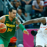 06 August 2012: Brazil Marquinhos Vieira Sousa drives past Spain Serge Ibaka during 88-82 Team Brazil victory over Team Spain, during the men's basketball preliminary, at the Basketball Arena, in London, Great Britain.