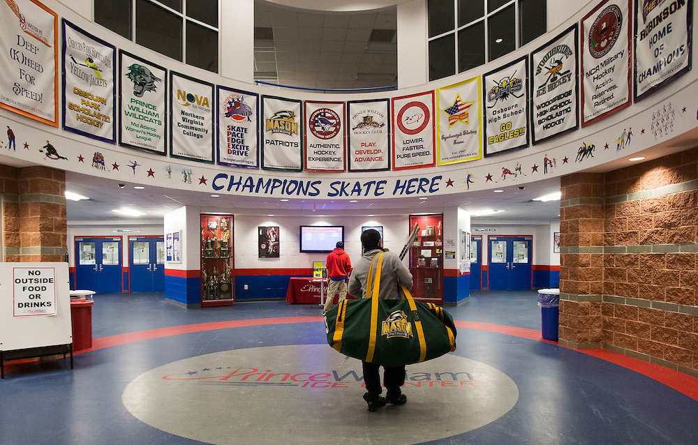 George Mason forward, Seve Cordova, walks through the main lobby to get to the locker room before practice at Prince William Ice Rink in Woodbridge, VA on January 22, 2014.