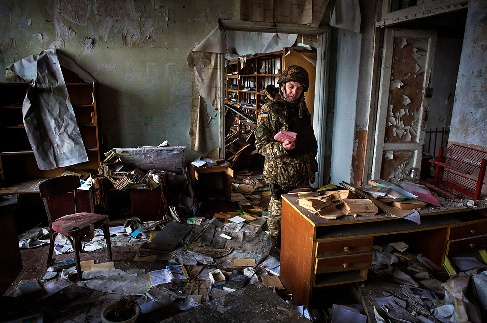 Pisky, Nr Avdiivka, eastern Ukraine, Nov. 2017.<br /> <br /> A serviceman in the Ukrainian army, in what remains of the school in the devastated village of Pisky, on the outskirts of Avdiivka in eastern Ukraine.<br /> <br /> The village is on the front-line and under frequent attack by sniper, rocket and artillery fire from pro-Russian separatists.