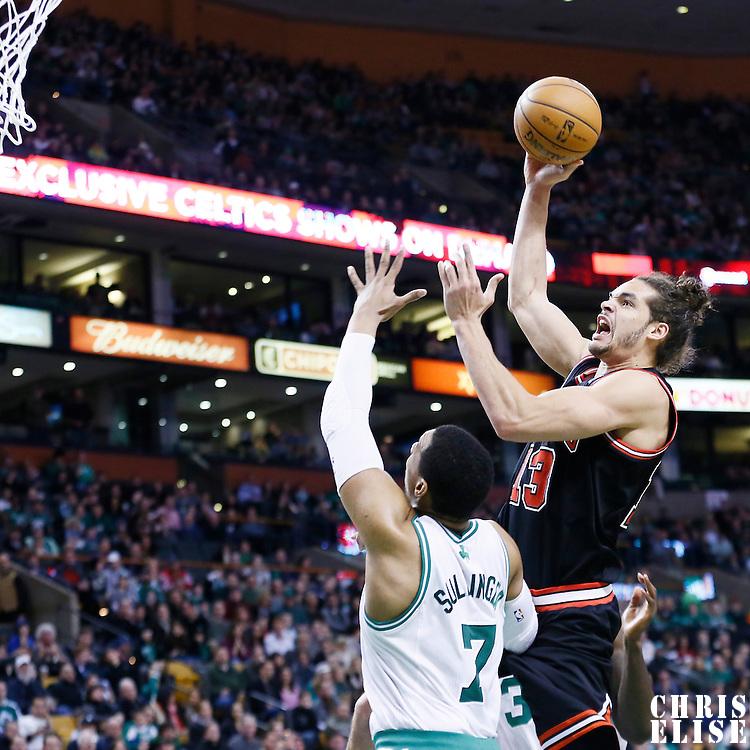 18 January 2013: Chicago Bulls center Joakim Noah (13) goes for the skyhook over Boston Celtics power forward Jared Sullinger (7) during the Chicago Bulls 100-99 overtime victory over the Boston Celtics at the TD Garden, Boston, Massachusetts, USA.