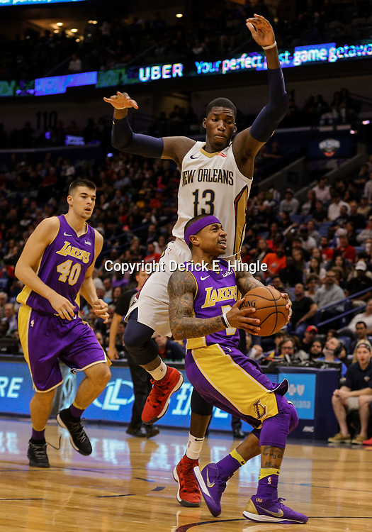 Mar 22, 2018; New Orleans, LA, USA; New Orleans Pelicans forward Cheick Diallo (13) defends Los Angeles Lakers guard Isaiah Thomas (3) during the first quarter at the Smoothie King Center. Mandatory Credit: Derick E. Hingle-USA TODAY Sports