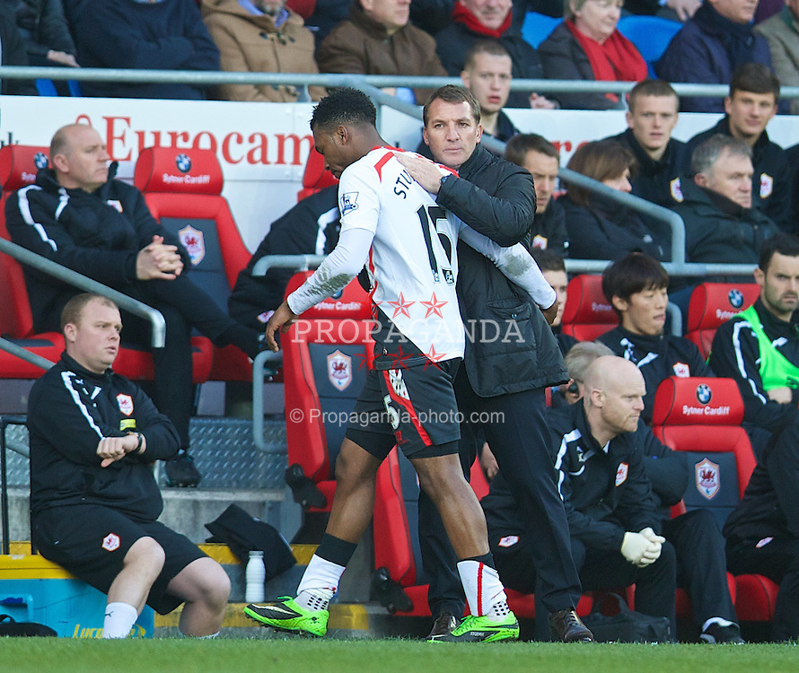 CARDIFF, WALES - Saturday, March 22, 2014: Liverpool's Daniel Sturridge is substituted by manager Brendan Rodgers during the Premiership match against Cardiff City at the Cardiff City Stadium. (Pic by David Rawcliffe/Propaganda)
