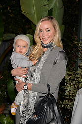 Noelle Reno and her son Zander Perks at The Ivy Chelsea Garden's Guy Fawkes Party, 197 King's Road, London, England. 05 November 2017.