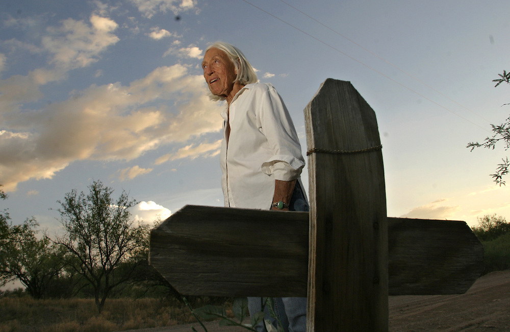 No More Deaths patron Byrd Baylor, 82, stands on 15 July 2006 next to a cross marking the place where she found the body of an undocumented immigrant in the Arizona town of  Arvaka.