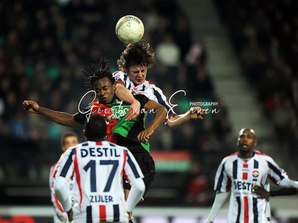 21-0309 Voetbal:NEC Nijmegen:Willem II:Nijmegen<br /> Niels Vorthoren in een luchtduel met Lorenzo Davids<br /> Foto: Geert van Erven