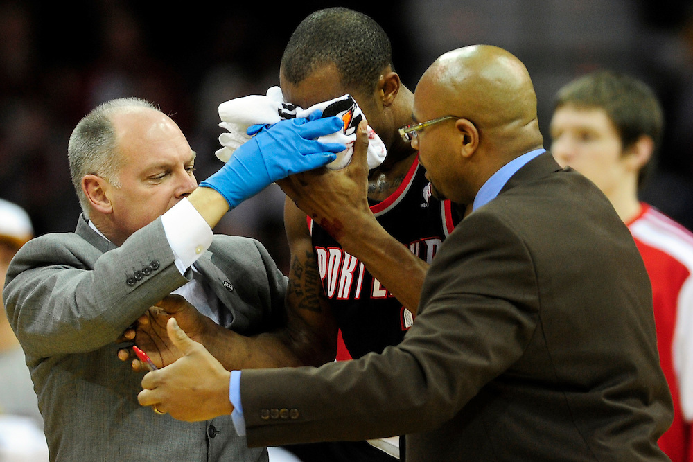 Feb. 5, 2011; Cleveland, OH, USA; Portland Trail Blazers forward Dante Cunningham (33) is helped off the court by team trainers after he was hit in the face during the first quarter against the Cleveland Cavaliers at Quicken Loans Arena. Mandatory Credit: Jason Miller-US PRESSWIRE