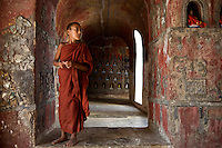 A young monk at the Shwe Yan Pyay Monastery's auxiliary building at Inle Lake in Myanmar.
