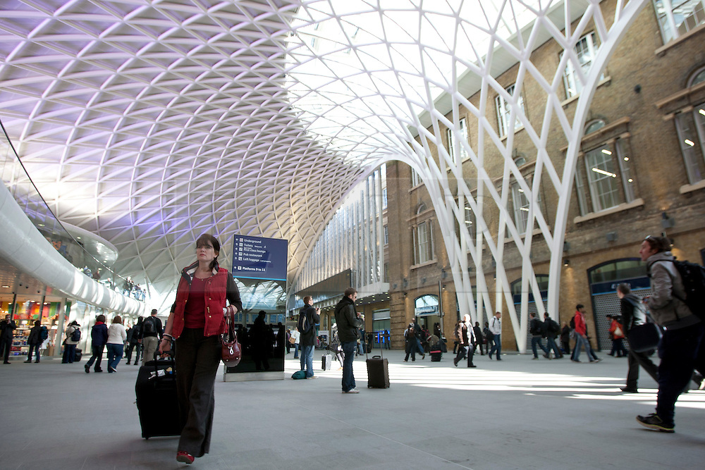 © licensed to London News Pictures. London, UK 19/03/2012. Commuters walk through the new concourse at King's Cross train station in London which opened to commuters today (19/03/2012). Photo credit: Tolga Akmen/LNP