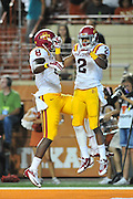 AUSTIN, TX - OCTOBER 18:  Aaron Wimberly #2 of the Iowa State Cyclones celebrates after scoring a touchdown with D'Vario Montgomery #8 against the Texas Longhorns on October 18, 2014 at Darrell K Royal-Texas Memorial Stadium in Austin, Texas.  (Photo by Cooper Neill/Getty Images) *** Local Caption *** Aaron Wimberly; D'Vario Montgomery