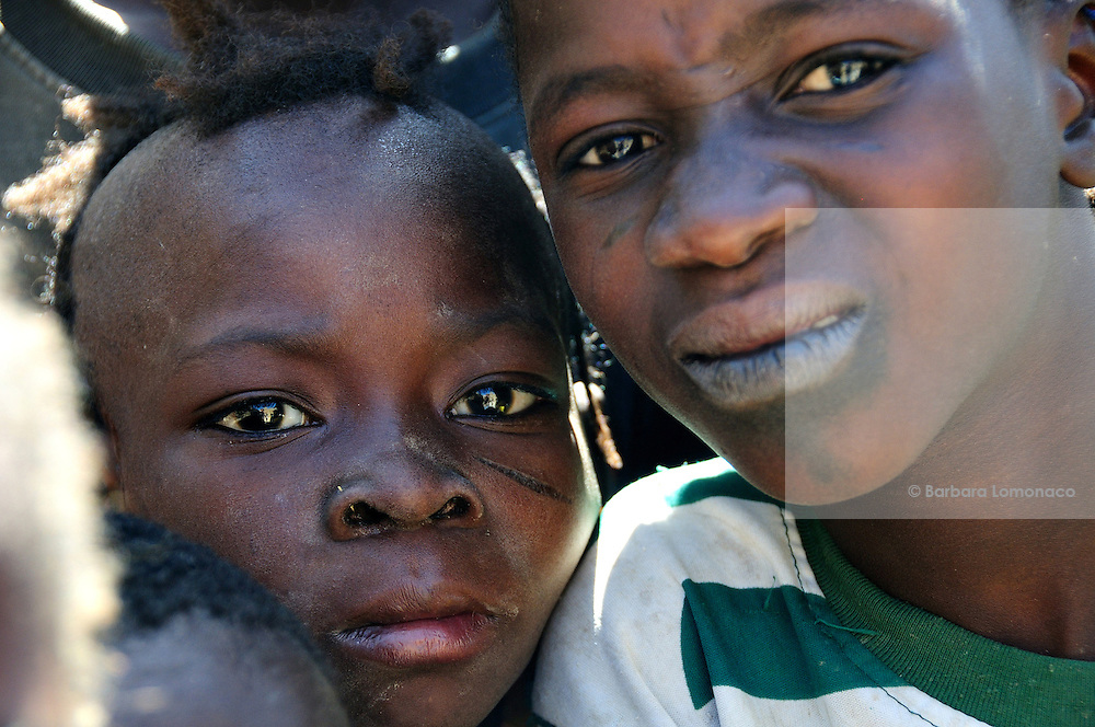 Children stare at the camera in the Saharan village of Moussoukourare