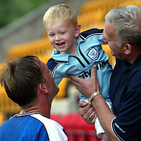 St Johnstone v Hamilton Accies..31.07.04  Bell's Cup<br />Ian Maxwell with son Christopher<br /><br />Picture by Graeme Hart.<br />Copyright Perthshire Picture Agency<br />Tel: 01738 623350  Mobile: 07990 594431