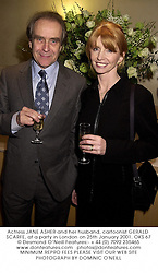 Actress JANE ASHER and her husband, cartoonist GERALD SCARFE, at a party in London on 25th January 2001.OKS 67