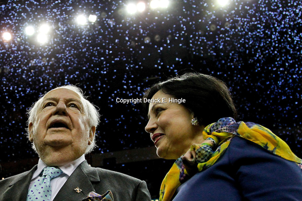 April 15, 2012; New Orleans, LA, USA; New Orleans Hornets newly named owner Tom Benson along with his wife Gayle celebrate as confetti falls behind them following a 88-75 win over the Memphis Grizzlies at the New Orleans Arena.   Mandatory Credit: Derick E. Hingle-USA TODAY SPORTS