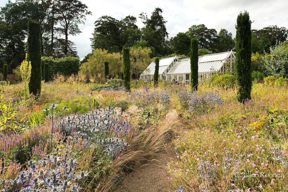 A view the walled garden and greenhouse in late summer; Broughton Grange, Banbury, Oxfordshire, UK