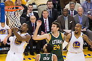 Golden State Warriors forward Kevin Durant (35) lays the ball into the basket against the Utah Jazz at Oracle Arena in Oakland, Calif., on December 20, 2016. (Stan Olszewski/Special to S.F. Examiner)