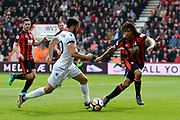 Andros Townsend (10) of Crystal Palace on the attack with Nathan Ake (5) of AFC Bournemouth looking to stop him during the Premier League match between Bournemouth and Crystal Palace at the Vitality Stadium, Bournemouth, England on 7 April 2018. Picture by Graham Hunt.