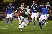Scott Arfield of Burnley gets a shot away  during the Sky Bet Championship match between Burnley and Cardiff City at Turf Moor, Burnley, England on 5 April 2016. Photo by Simon Brady.