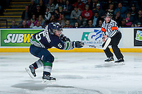 KELOWNA, CANADA - APRIL 3: Sam McKechnie #5 of the Seattle Thunderbirds takes a shot against the Kelowna Rockets on April 3, 2014 during Game 1 of the second round of WHL Playoffs at Prospera Place in Kelowna, British Columbia, Canada.   (Photo by Marissa Baecker/Getty Images)  *** Local Caption *** Sam McKechnie;