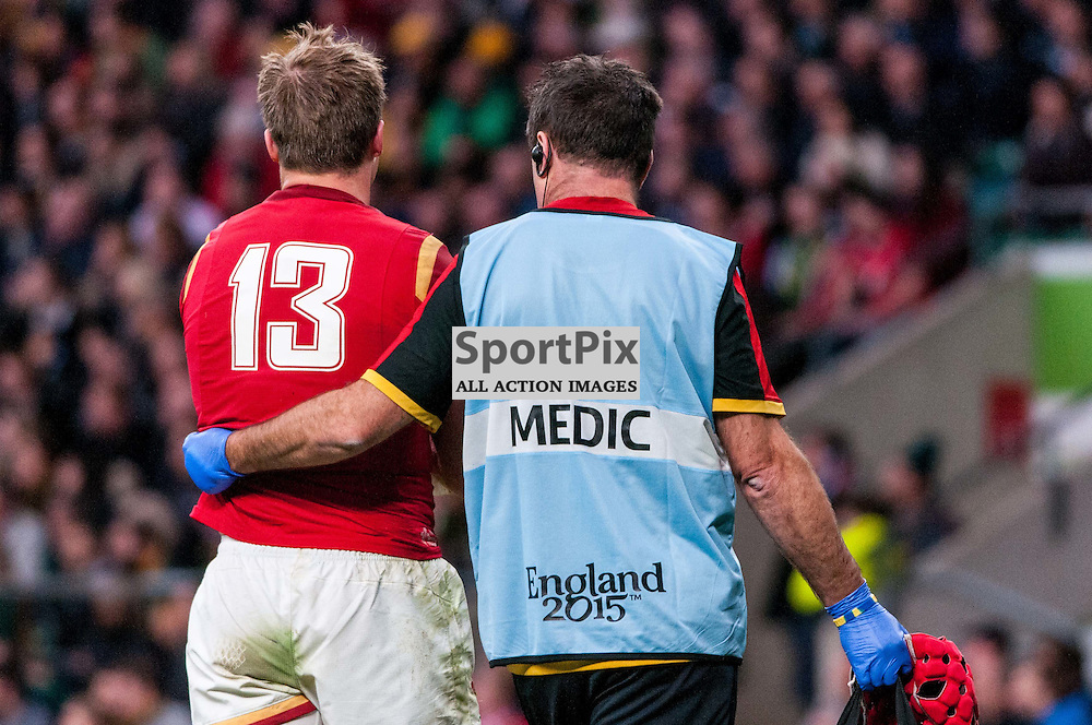 Tyler Morgan of Wales walks away injured. Action from the South Africa v Wales quarter final game at the 2015 Rugby World Cup at Twickenham in London, 17 October 2015. (c) Paul J Roberts / Sportpix.org.uk