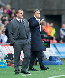 SWANSEA, WALES - Sunday, March 11, 2012: Manchester City's manager Roberto Mancini and Swansea City's manager Brendon Rodgers during the Premiership match at the Liberty Stadium. (Pic by David Rawcliffe/Propaganda)
